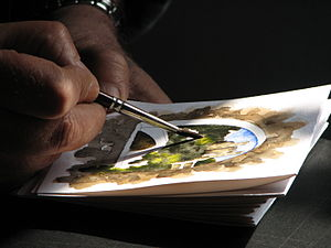 Artist using watercolor